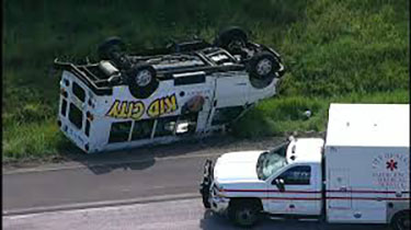 Day Care Van Carrying 9 Children Flips Upside Down in Alvin